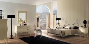 Dormitorio con forja en el cabecero en Zaragoza