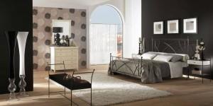 Cabecero de forja sencillo en dormitorio Zaragoza