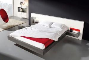 Manta roja en dormitorio moderno en Zaragoza