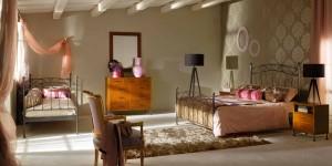 Dormitorio con forja gris en Zaragoza